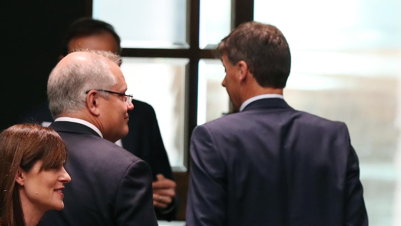 Energy Minister Angus Taylor and PM Scott Morrison leaving the House of Representatives Chamber after a division, Parliament House in Canberra. Picture Kym Smith
