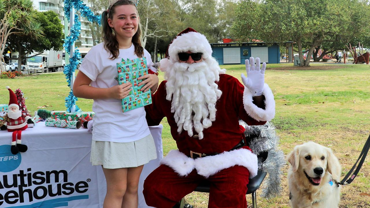 Ella and Santa are ready for the STEPS Autism Treehouse Christmas Party. Picture: Contributed