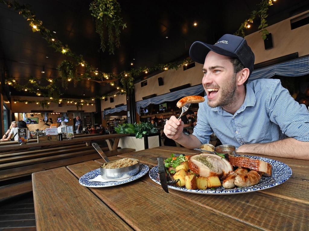 Journalist Matty Holdsworth samples the array of foods. Photo Patrick Woods / Sunshine Coast Daily.