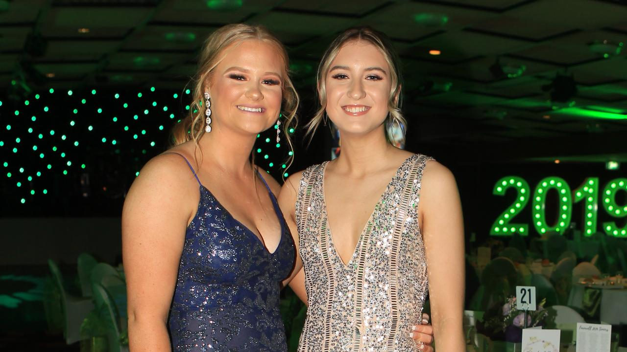 Olivia Millward (left) and Amy McCarthy enjoy the evening at St Ursula's College formal at Rumours.