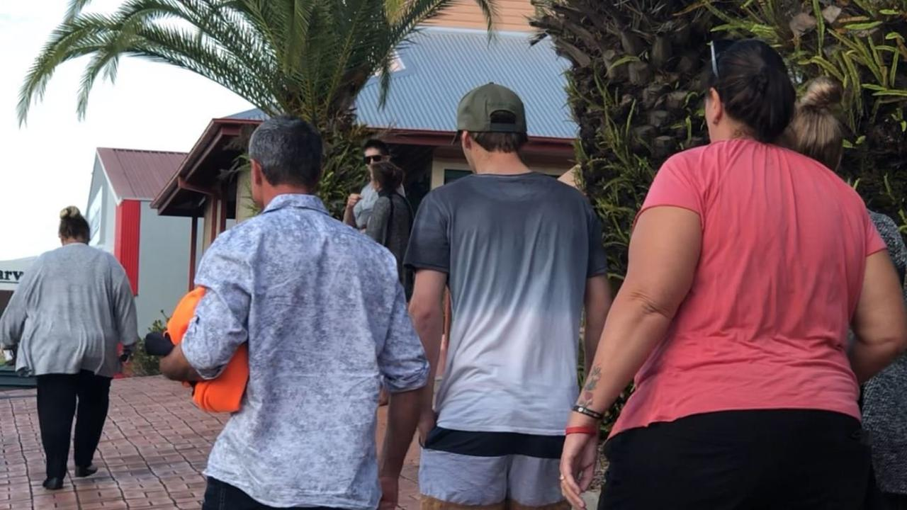 Mitchell Grimston (middle) was surrounded by family members when he was released on bail after facing charges of manslaughter at Lismore Local Court.