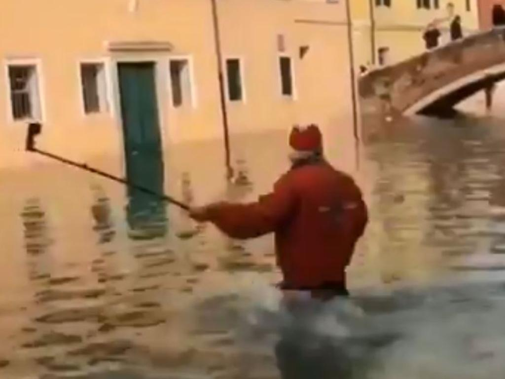 A tourist in Venice got a little ambitious when taking a selfie in the flooded city. Picture: @_SJPeace_