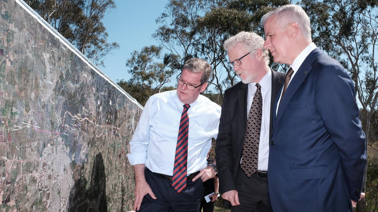 Groom MP Dr John McVeigh, ARTC Inland Rail Programme CEO Richard Wankmuller, and Deputy Prime Minister Michael McCormack look over plans for the Inland Rail.