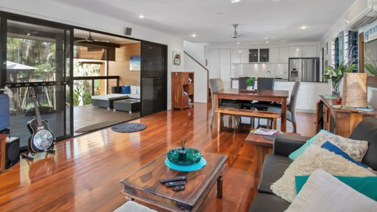 The main living area at 20 Edmonds Street, Bucasia offers a light and airy environment.