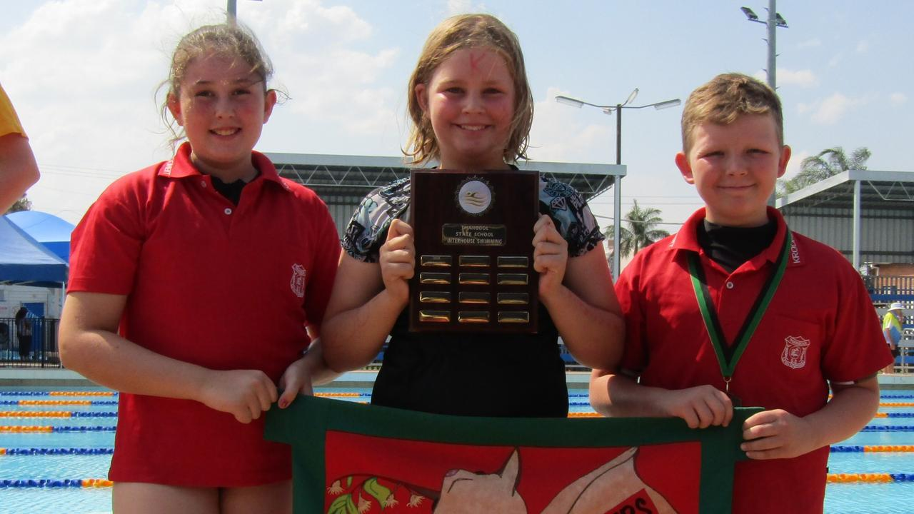SPLASH OF SUCCESS: Kroombit House captains hoist the winning plaque at the swimming carnival.