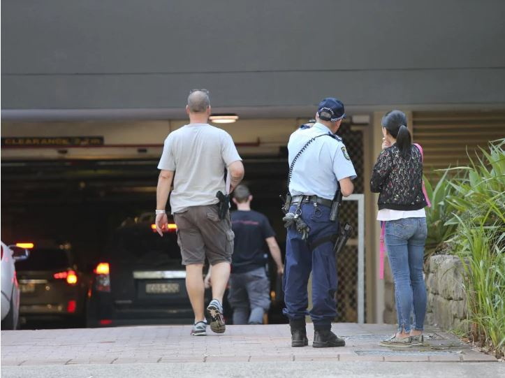 Police speak with residents. Picture: Richard Dobson