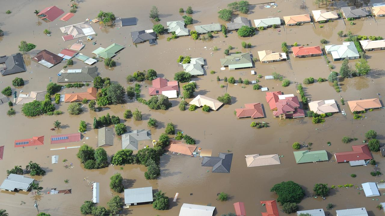 Homes in the town of Ipswich west of Brisbane are inundated by flood waters Jan. 12, 2011. (AAP Image/Dave Hunt)