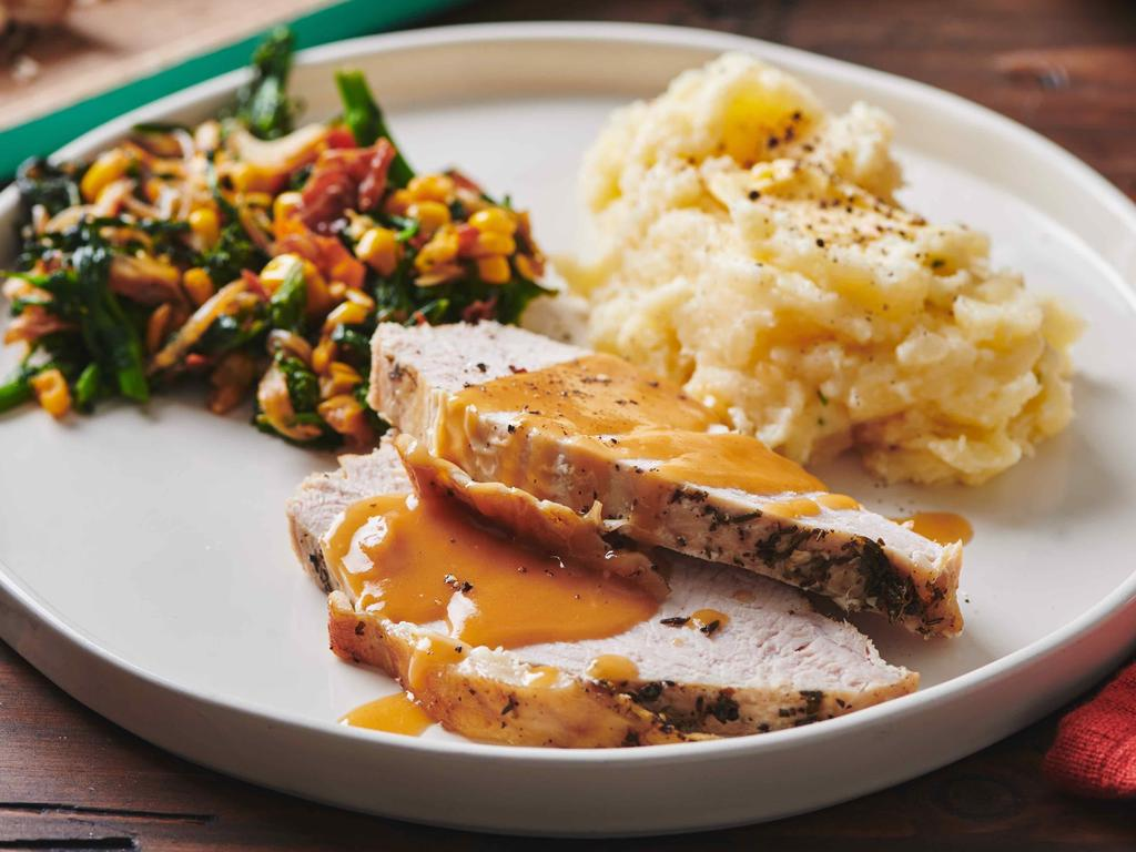 Turkey with gravy, mash potatoes and a side of sauteed broccoli rabe, corn and onions with crispy bacon. The yanks take their Thanksgiving lunch very seriously. Picture: Cheyenne Cohen/Katie Workman via AP