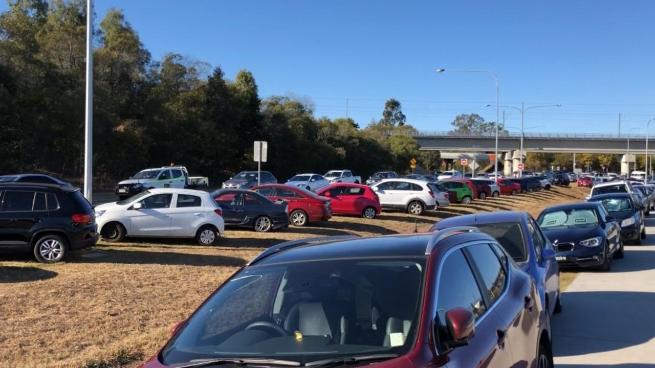 Cars parking on nature strips at Springfield Central Train Station.