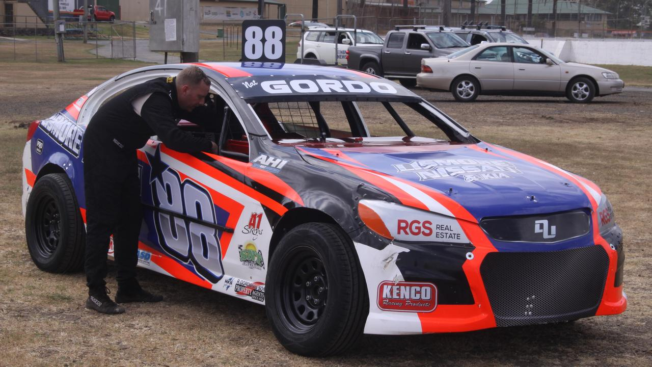 Nathan Gordon checks out his Holden Commodore race car in the countdown to tonight's The Dream production sedan 30-lap feature race at Castrol Edge Lismore Speedway. Photo: Tony Powell