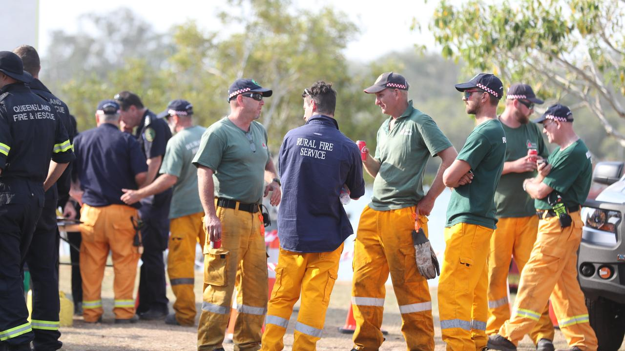 Firefighters rest behind the front line at Tewantin last month. They are now gearing for a tough start to summer with soaring temperatures and dry winds to create Severe conditions for the days ahead. Pic Annette Dew