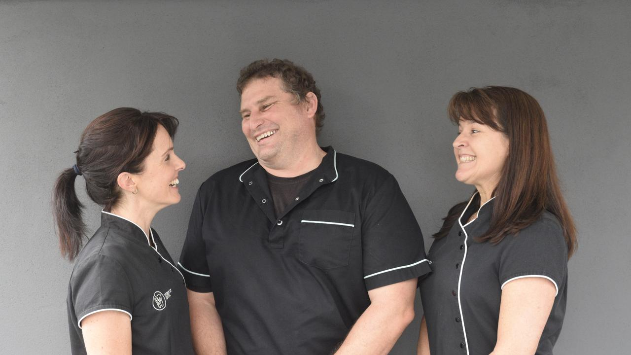 BIG SMILES: Fitzroy St Dental owner Celina and Luke Symons and practice manager Sandra Woods.