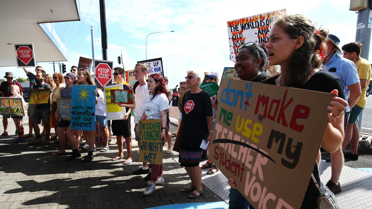 School Strike 4 Climate has held a climate change protest outside Member for Leichhardt Warren Entsch's electorate office on Mulgrave Road. University student Garrett Swearingen helped organise the protest, which was attended by about 50 people. PICTURE: BRENDAN RADKE
