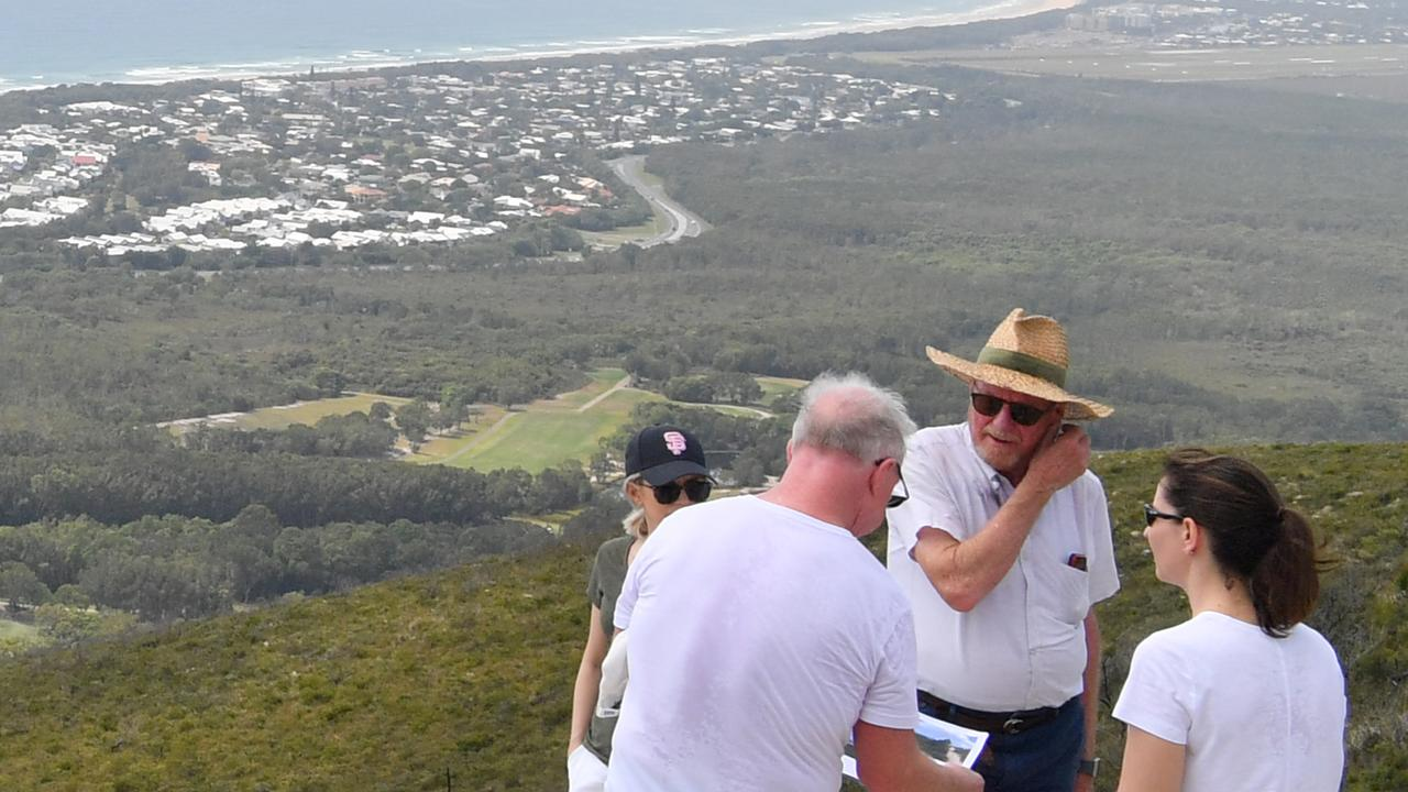 Legal teams and the judge involved in the Sekisui House hearing before the Planning and Environment Court hike up Mount Coolum early during the proceedings.. Photo: John McCutcheon / Sunshine Coast Daily