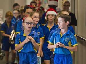Students bring Christmas cheer to hospital halls