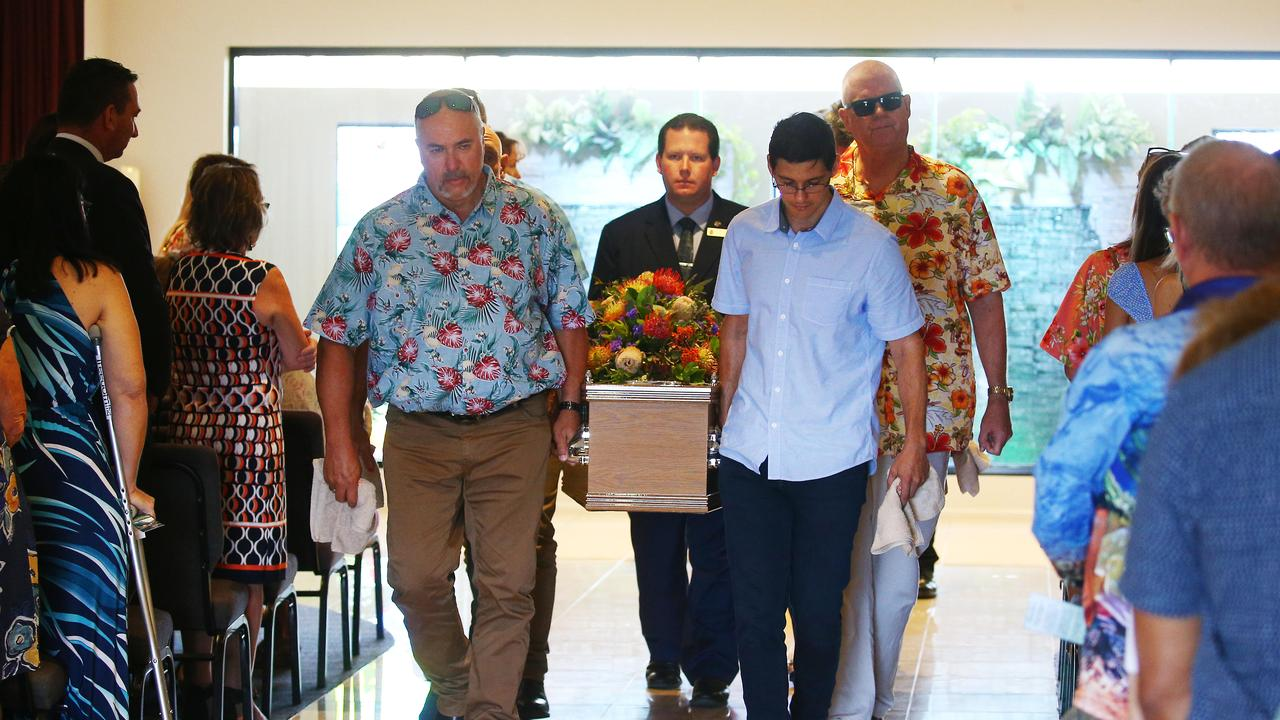 Brant Jones' brother in law Ross Hodgman and son Bryce Jones lead the pallbearers carrying the casket from the chapel at the end of the service. PICTURE: BRENDAN RADKE