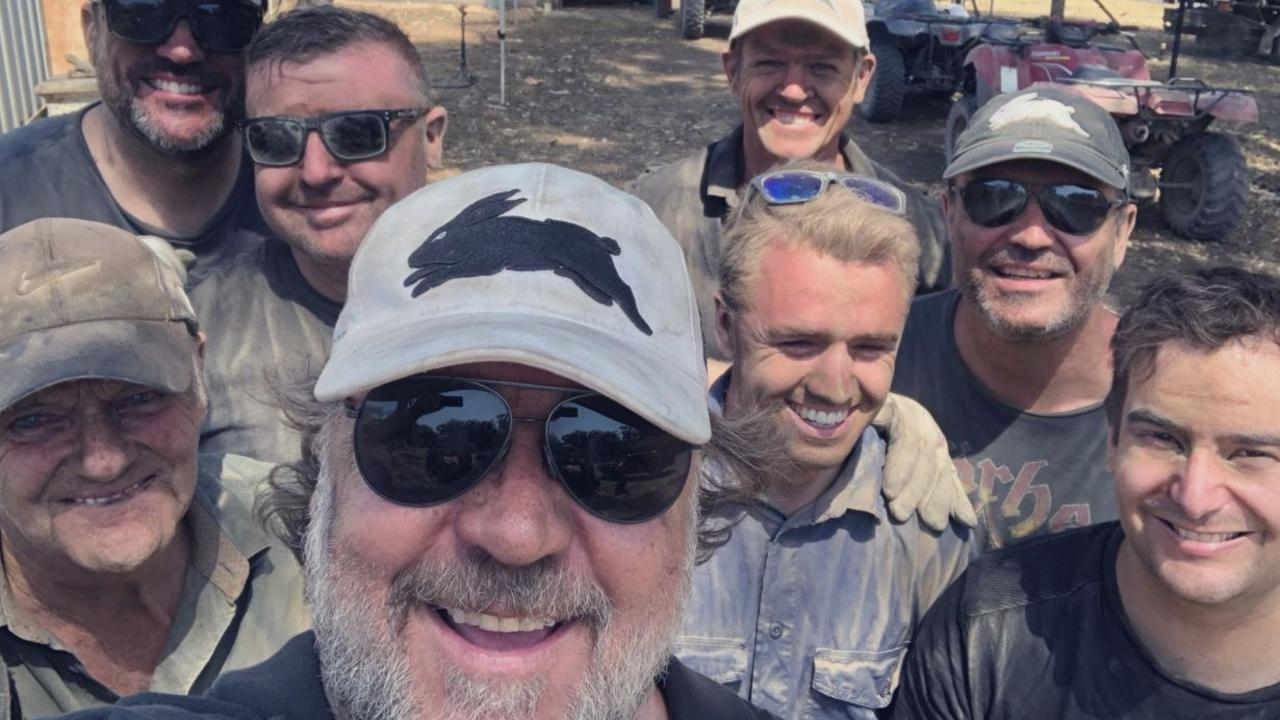 Russell Crowe wearing the now iconic hat days before he auctioned it off while helping out neighbours in burnt out areas of Nana Glen.