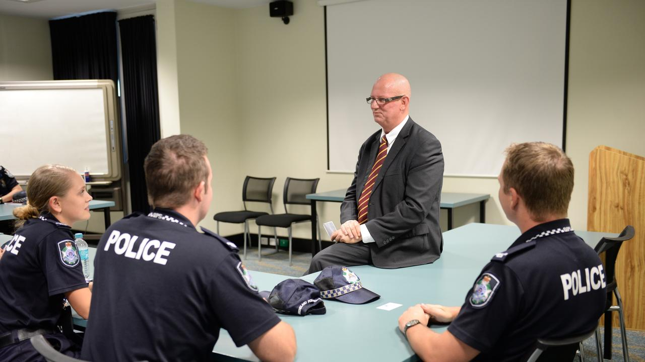 Police minister Bill Byrne chats to new recruits in 2016. Photo Allan Reinikka