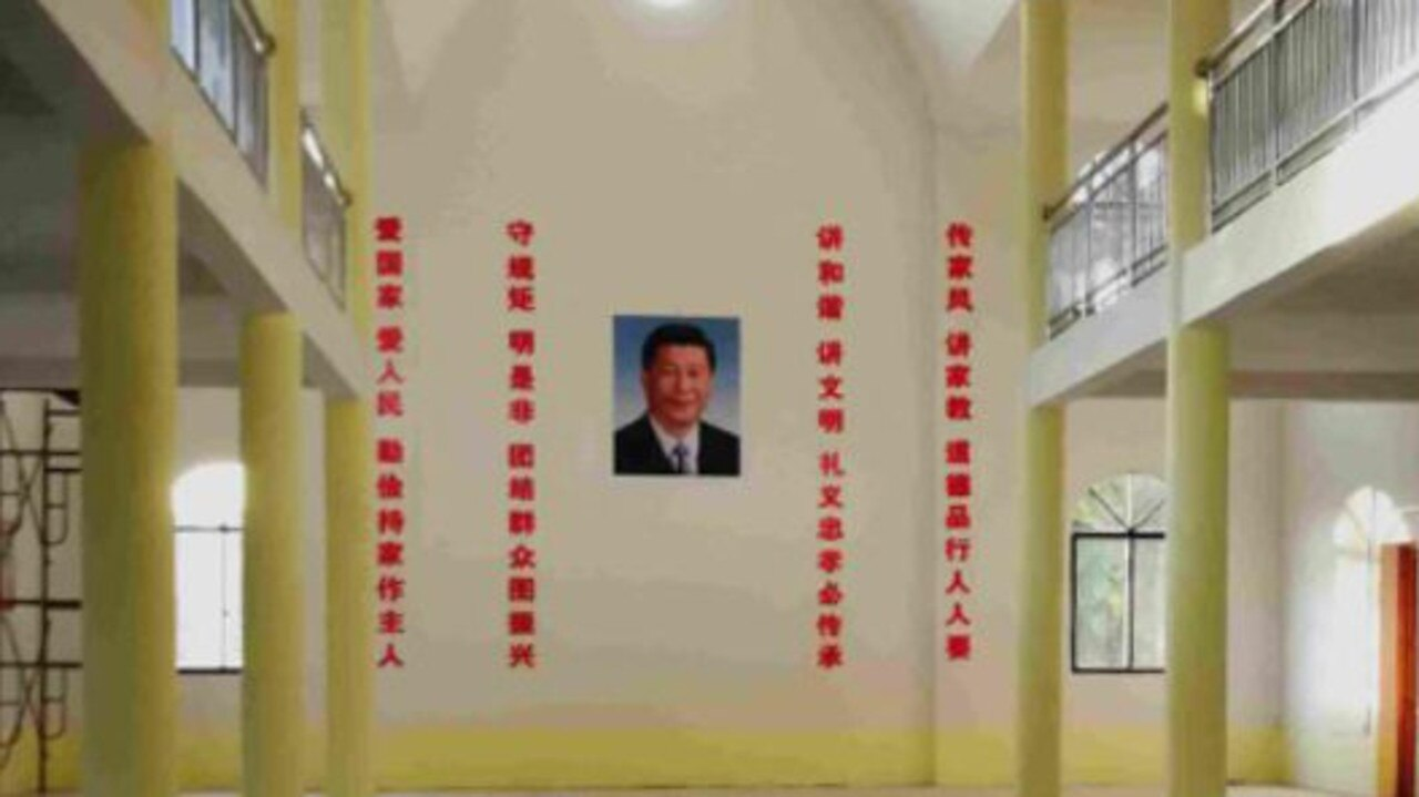 It looks like an innocuous photo of Xi Jinping hung up on a wall, but this image is more unsettling than it appears.