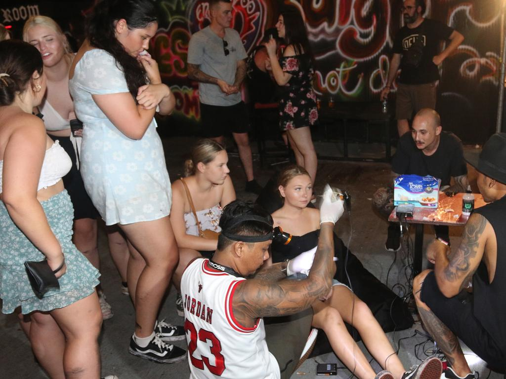 Hygiene has been thrown out the door for schoolies eager for a cheap tat in Bali. Picture: Lukman S. Bintoro
