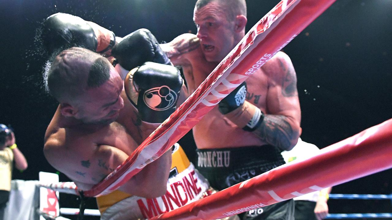 John Wayne Parr forces Anthony Mundine onto the ropes on Saturday night. Picture: AAP