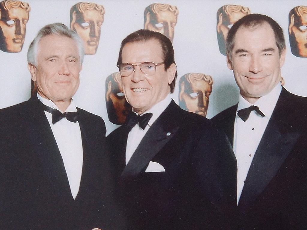Lazenby with former James Bond stars Roger Moore and Timothy Dalton.