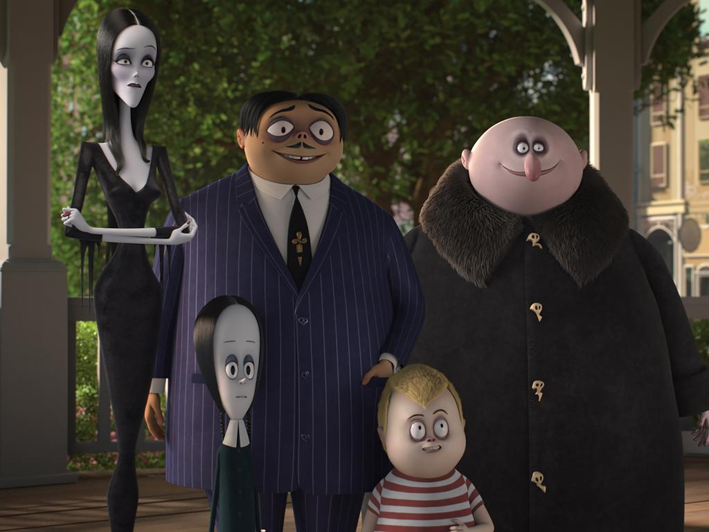 Morticia (Charlize Theron), Wednesday (Chloe Grace Moretz), Gomez (Oscar Isaac), Pugsley (Finn Wolfhard), and Uncle Fester (Nick Kroll) in The Addams Family.