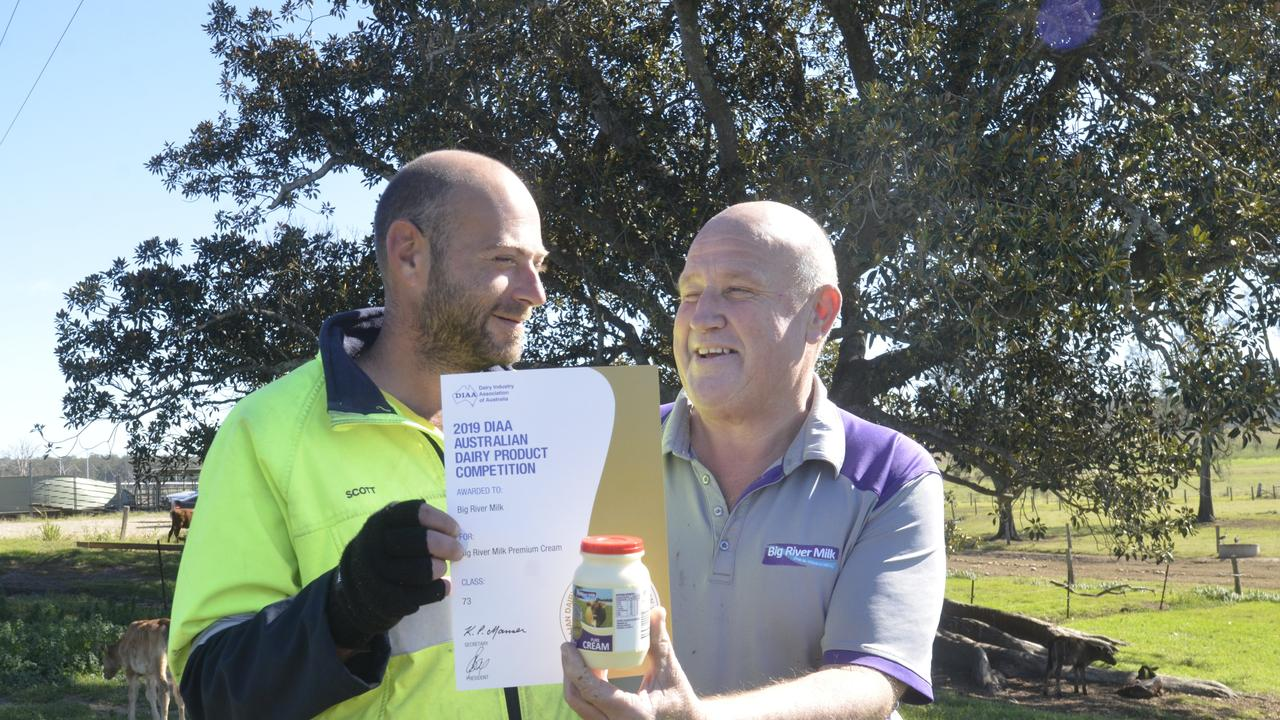 Big River Milk driver Scott Halovic and operations manager Barry Paff celebrate winning gold for its cream and silver for milk in the Australian Dairy Produce Competition in June.