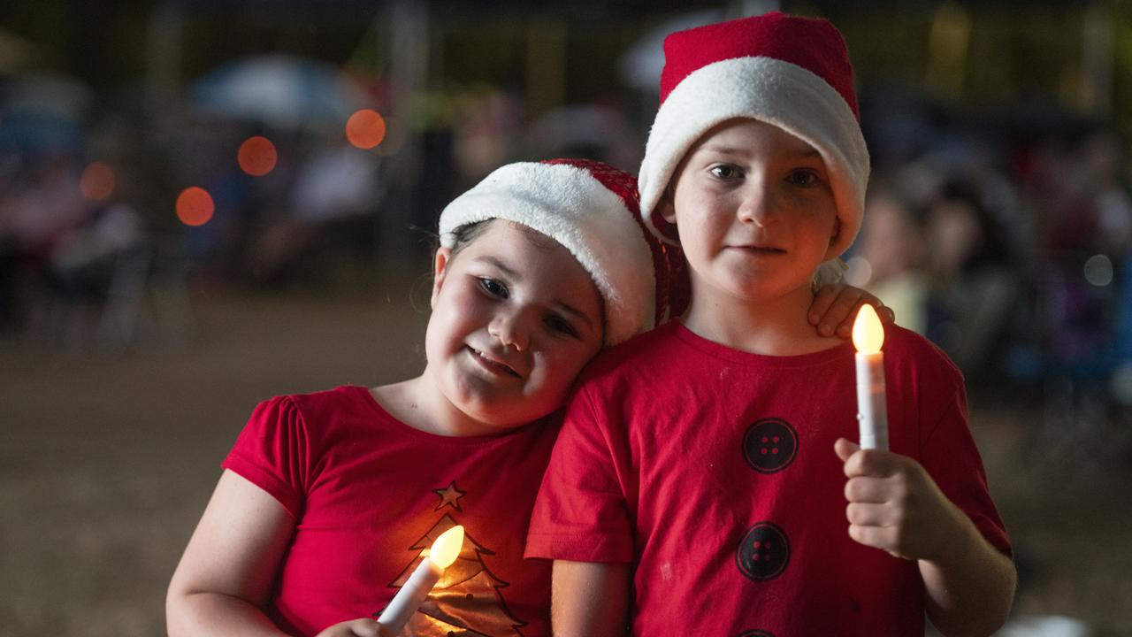 All smiles and Santa hats for Cailie and William Cootes at the Grafton Carols by Candlelight at Alumy Creek Reserve.