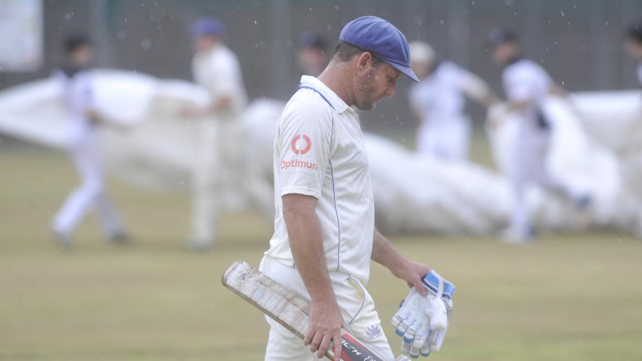 Harwood batsman Mark Ensbey comes from the field as Northern Districts players race to put the covers on the pitch for a rain delay in the North Coast Cricket Council Premier League round six match between Harwood and Northern Districts at High Street Playing Fields in Woolgoolga on Saturday, 30th November, 2019. Photo: Bill North