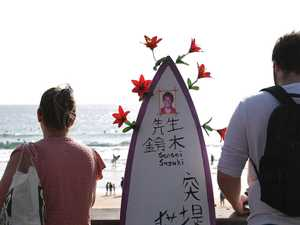 IN PHOTOS: Surfers honour loved teacher in paddle out