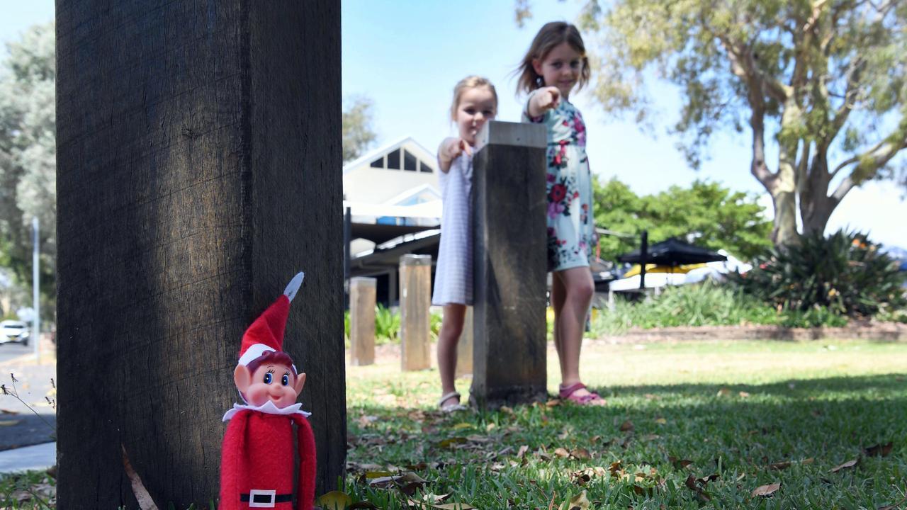 ELF IN A PARK: Harper, 7 and Eve, 5 Groznik spot a Fraser Elf hiding near the Urangan Pier. Photo: Cody Fox