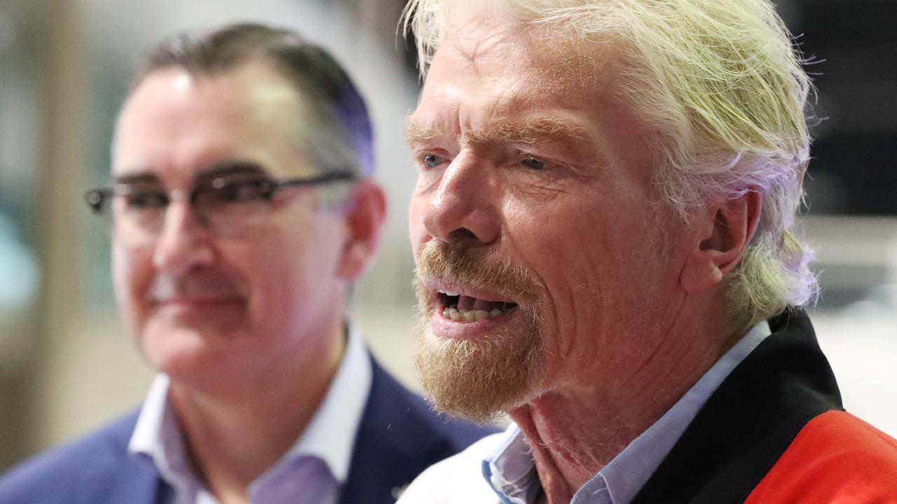 Virgin Australia's new CEO Paul Scurrah (background), with Sir Richard Branson promoting Virgin's new route to Tokyo from Brisbane. Picture: Liam Kidston.