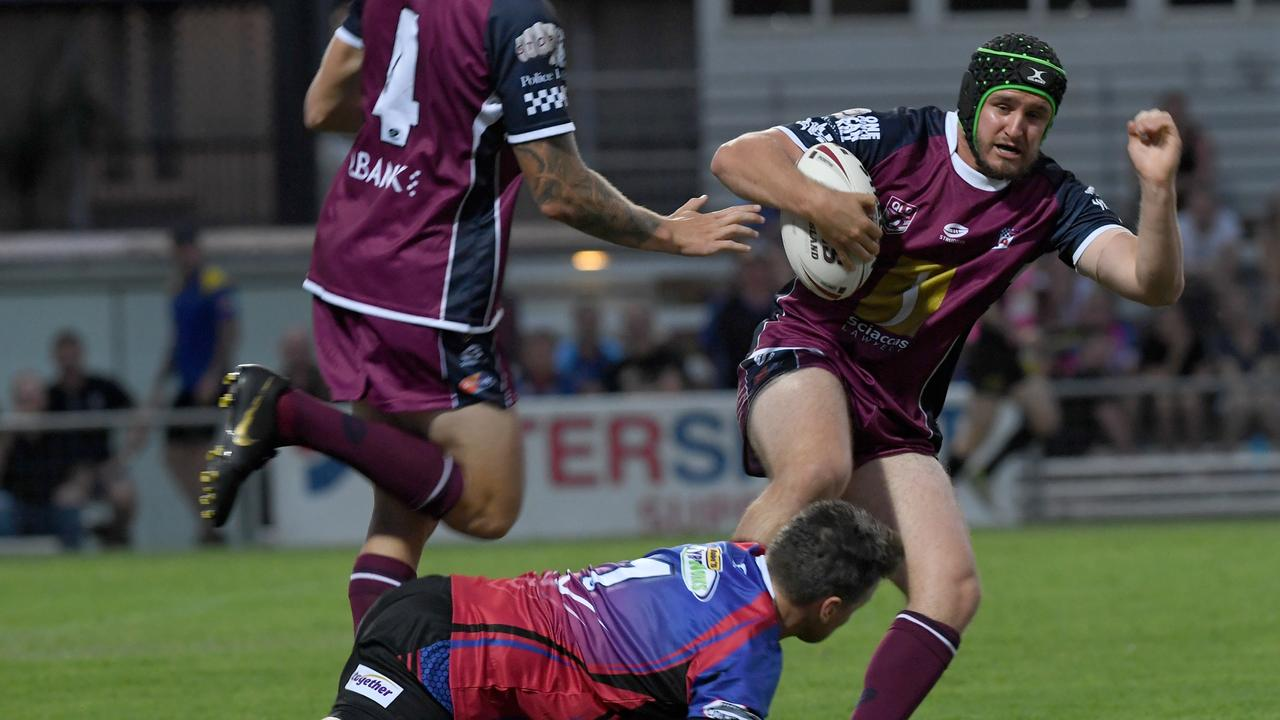 RUGBY LEAGUE: Correctional Services' Matt Solis tackles Queensland Police Services' Daniel Leyshon.   Picture: Jann Houley
