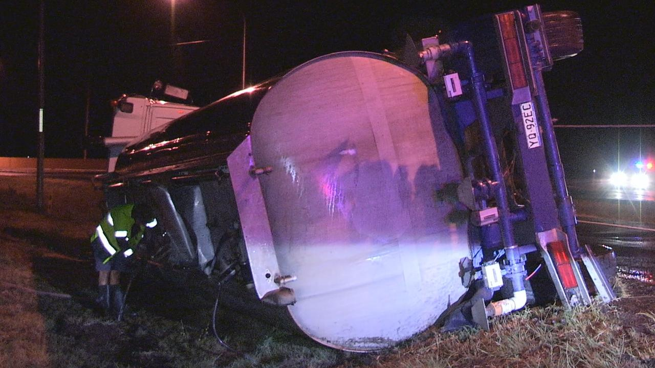 TURNED OVER: Truck rollover on the Cunningham Highway Sunday night.