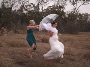 RAIN SOAKED WEDDING: Stanthorpe bride says rain 'made wedding'