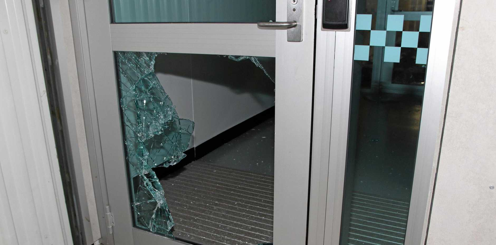 The back door at Bowen Police station after a 35-year-old man allegedly smashed his way in.