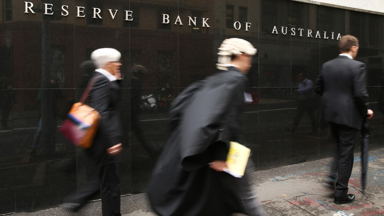 Pedestrians walk past the Reserve Bank of Australia (RBA) headquarters in Sydney, Australia.