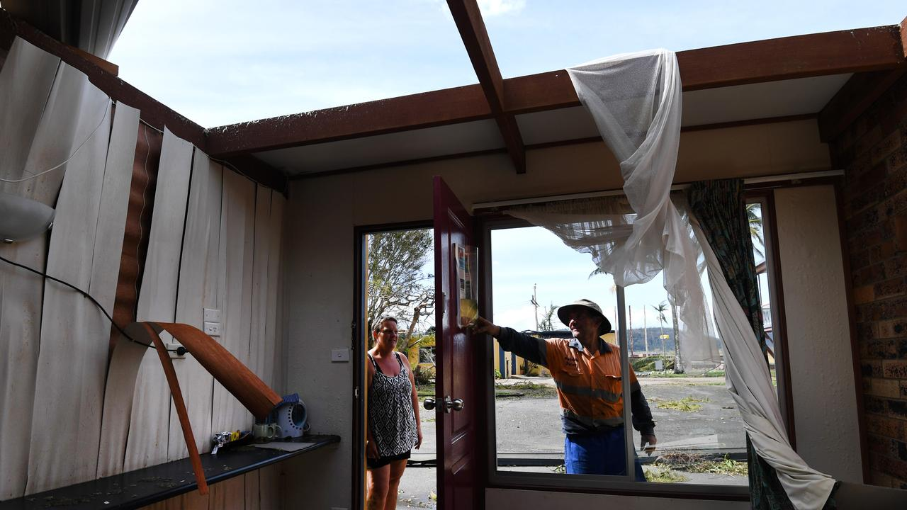 Kerry Campbell and Peter Stokes inspect damage to their motel in Proserpine, after Cyclone Debbie hit in 2017. More frequent and severe extreme weather events may put authorities who approved developments in vulnerable places in the firing line. Picture: AAP Image/Dan Peled