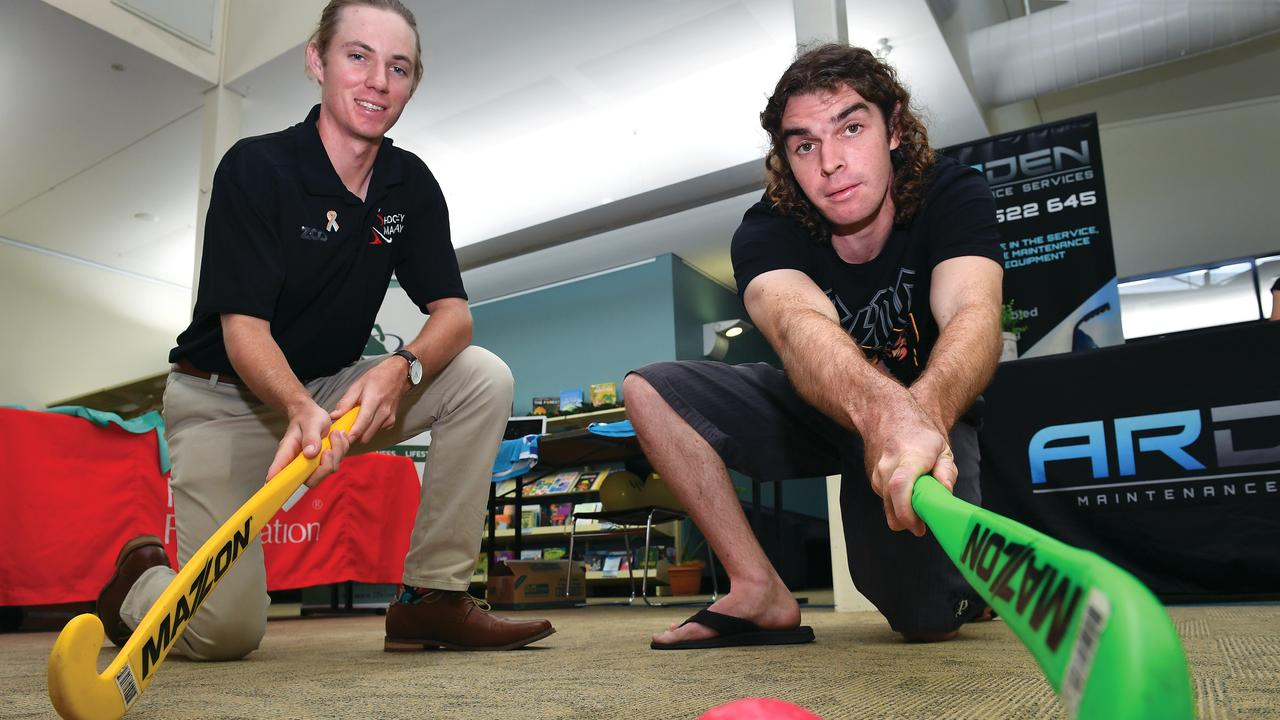 Mackay Hockey junior development officer Declan Mulherin and Robbie Usher at the Mackay Disability Expo. Picture: Tony Martin