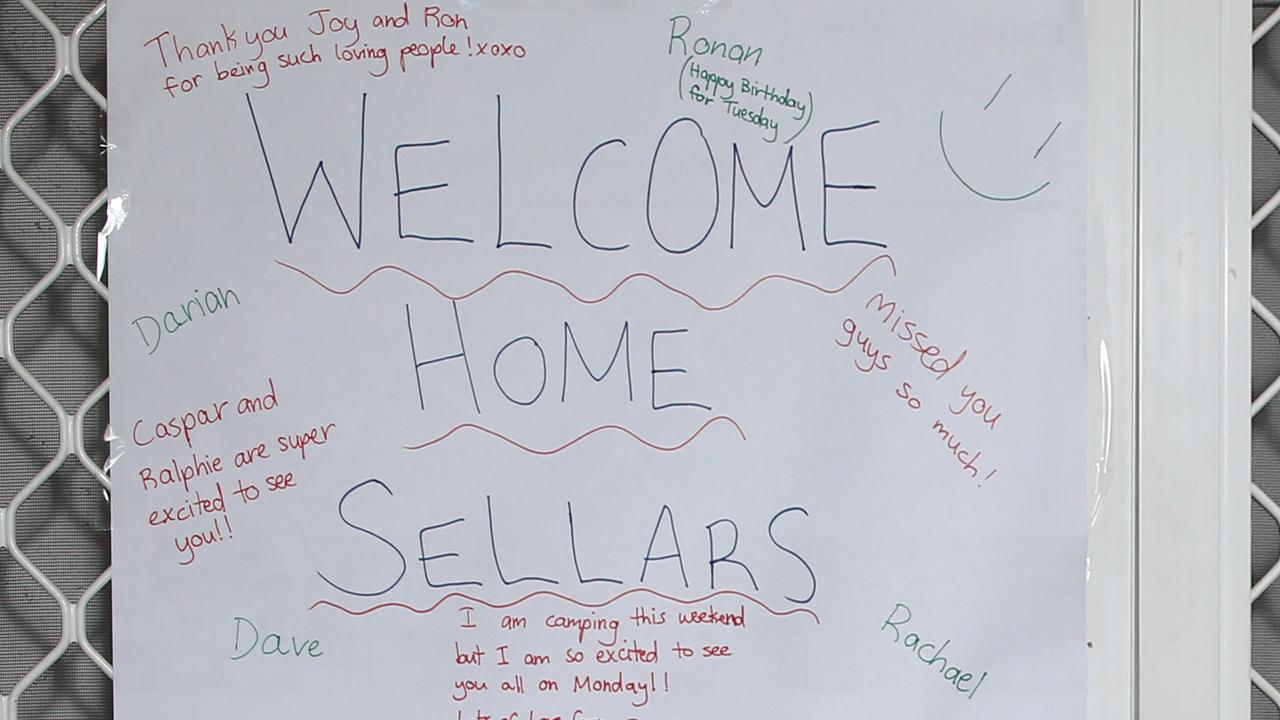 Neighbours wrote a welcome home poster to the boys on their return home to Cairns on Friday. PICTURE: BRENDAN RADKE