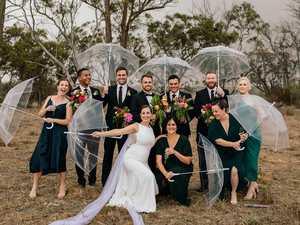 'Wall of water': Couple wed at rain soaked wedding