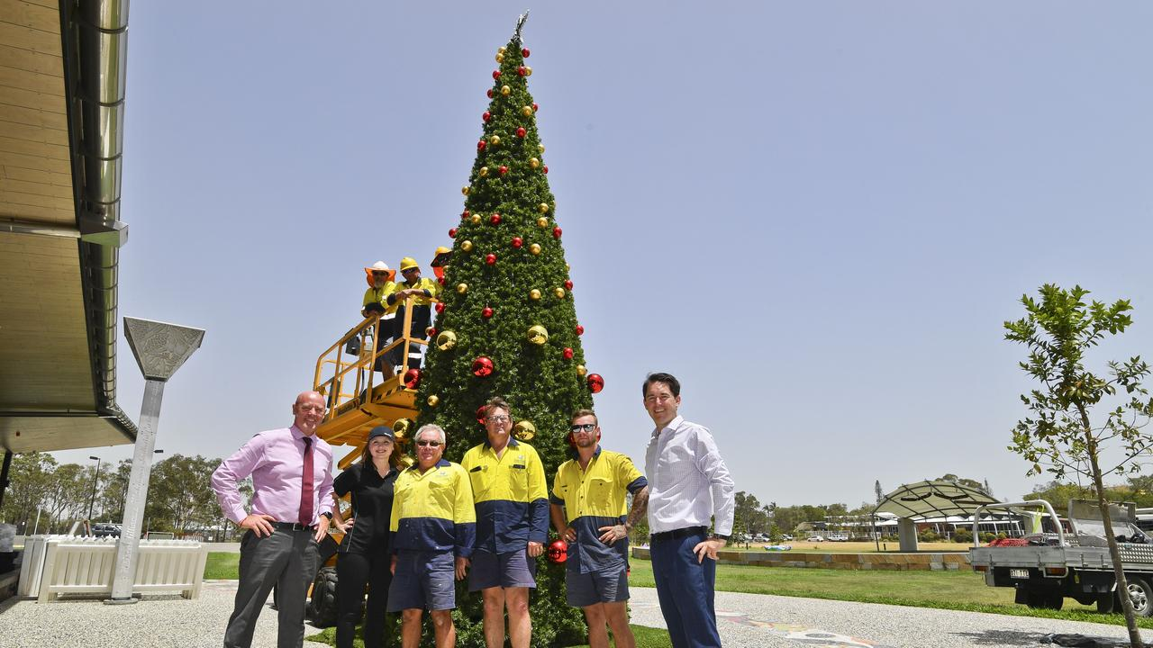 (above) Council workers Rodney Pettiford, Scott Smith and Brian Peterson (below) Deputy mayor Darren Everard, FCRC's community events support officer Michaela Davis with council workers Robert Neeves, Anthony McGill, Cameron Argus and mayor George Seymour at the installation of the brand new Hervey Bay Christmas Tree outside the Hervey Bay Regional Gallery and Cultural Centre.
