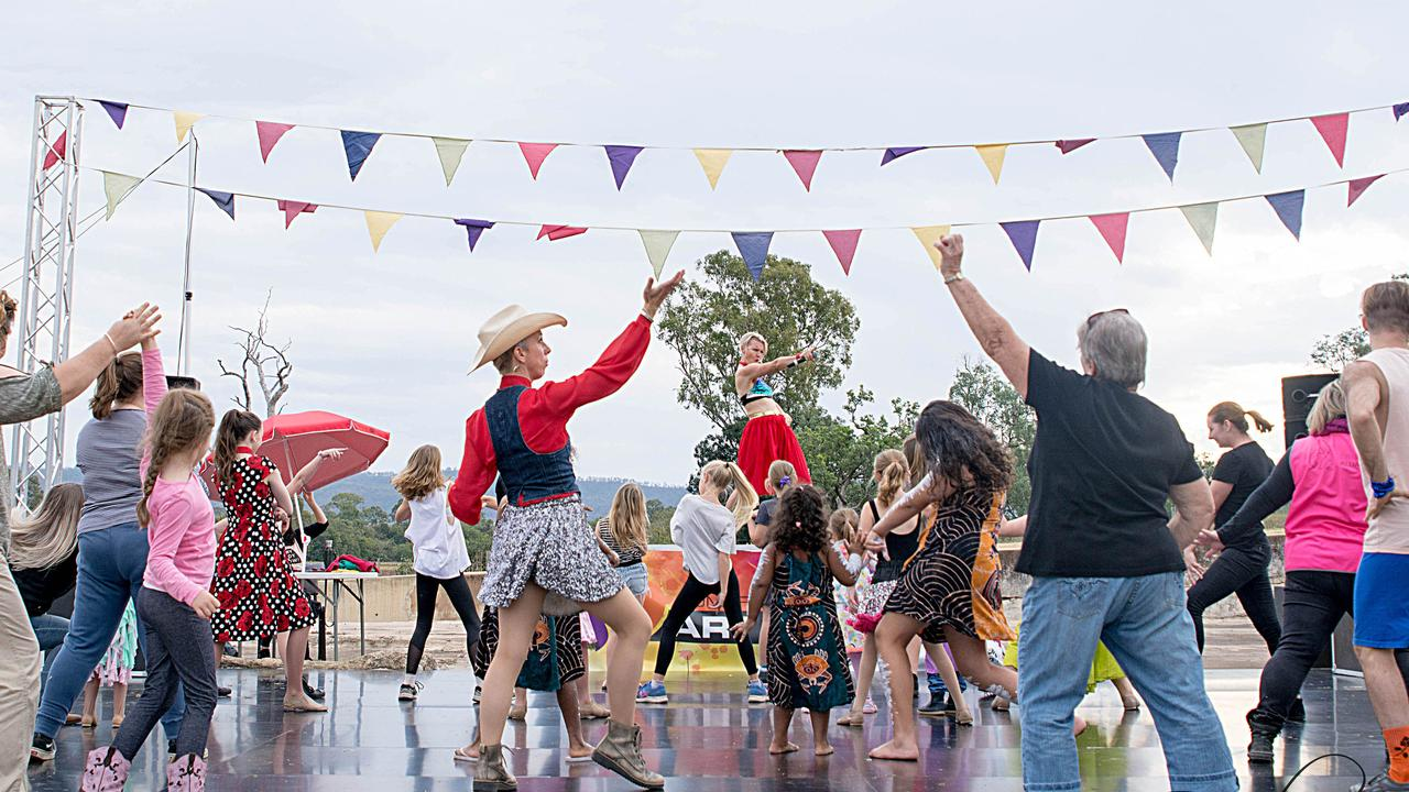 Everybody Now! Facilitators leading the crowd in dance performances at the Somerset Art Beat Festival in July.