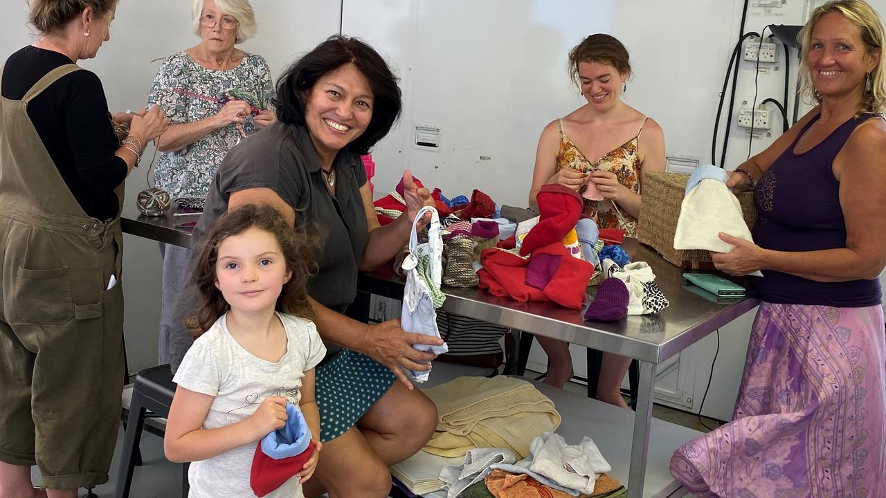 Sydney, aged, 5 helps other Eumundi volunteers.
