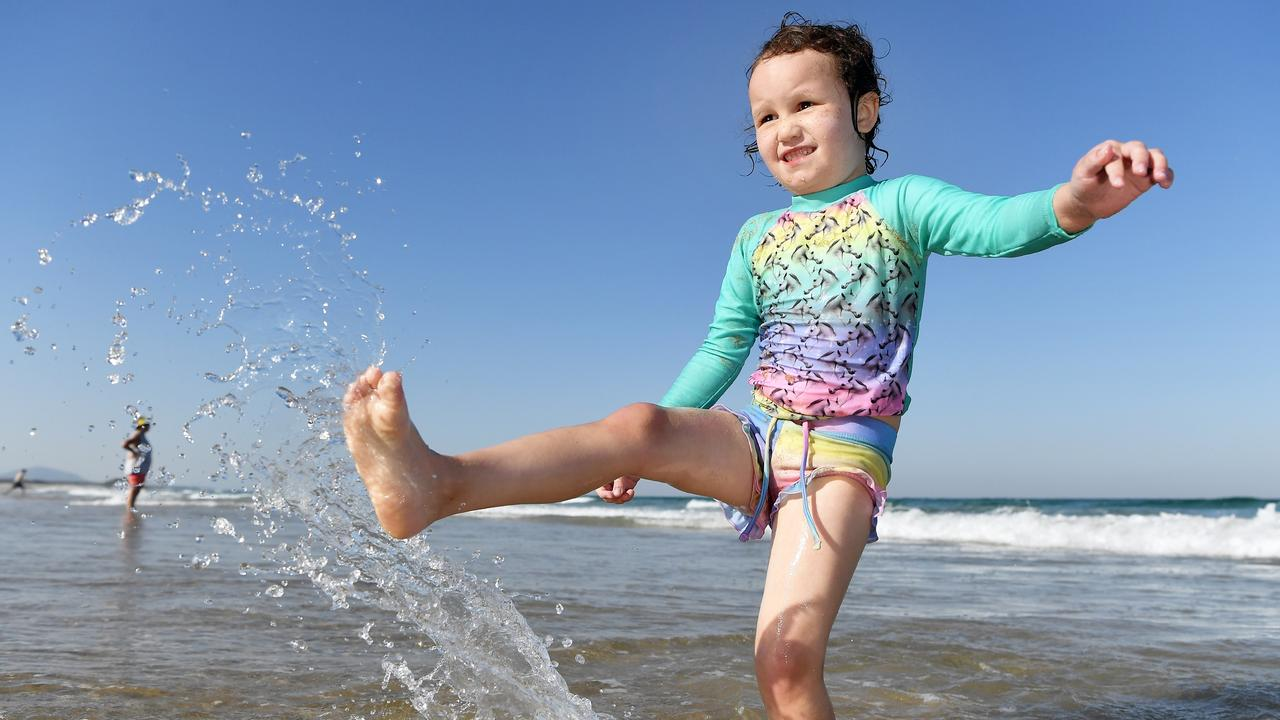 REFUGE: The beach will be the place to be in coming days, with temperatures set to soar across the Coast, leaving fireys bracing for trouble. Out cooling off on Maroochydore Beach is Polly Peterson, 3. Photo Patrick Woods / Sunshine Coast Daily.