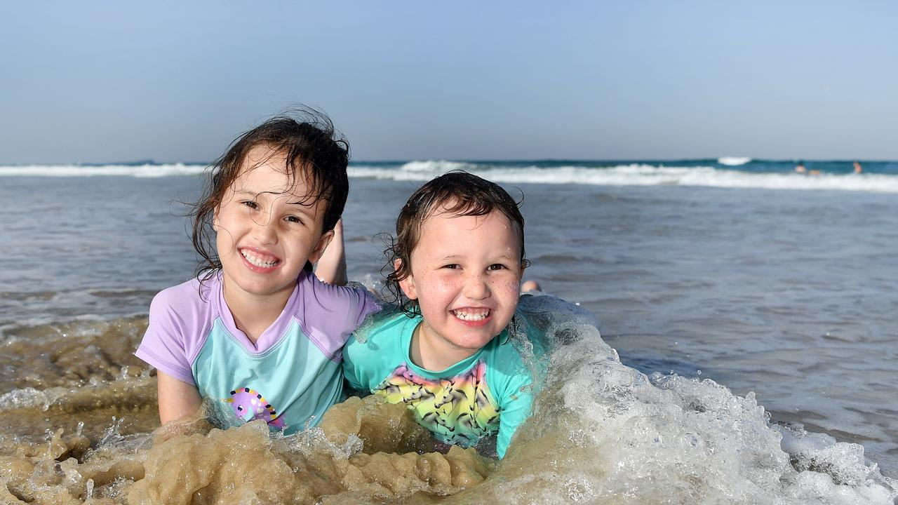 WEATHER: Out cooling off on Maroochydore Beach are Aurelia, 5, and Polly Peterson, 3. Photo Patrick Woods / Sunshine Coast Daily.