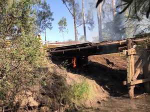 WATCH: Notorious Gympie region bridge up in flames