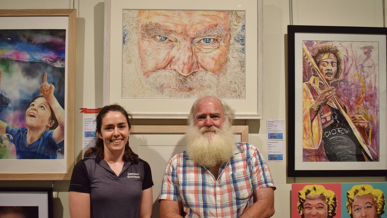 Laura-Jane Kemp won the Works on Paper category at the QAL People's Choice Award with her piece I Have My Dad's Eyes. Pictured with dad Brendan MacNamara