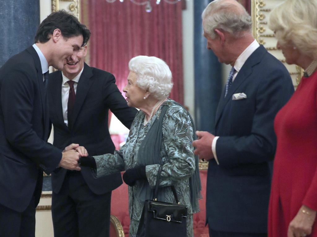 Prince Charles and Camilla watch as Queen Elizabeth is introduced to Canadian Prime Minister Justin Trudeau during a reception at Buckingham Palace. Picture: AP